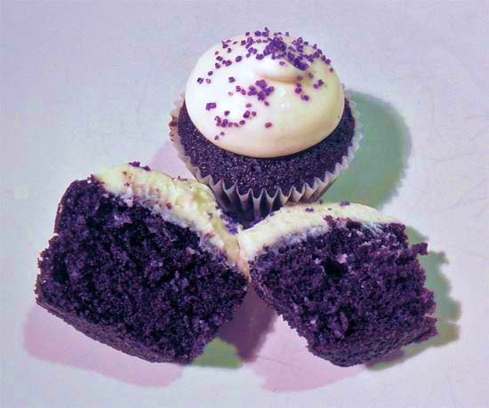 purple velvet cupcake, white icing, purple sprinkles - would be great with black sprinkles