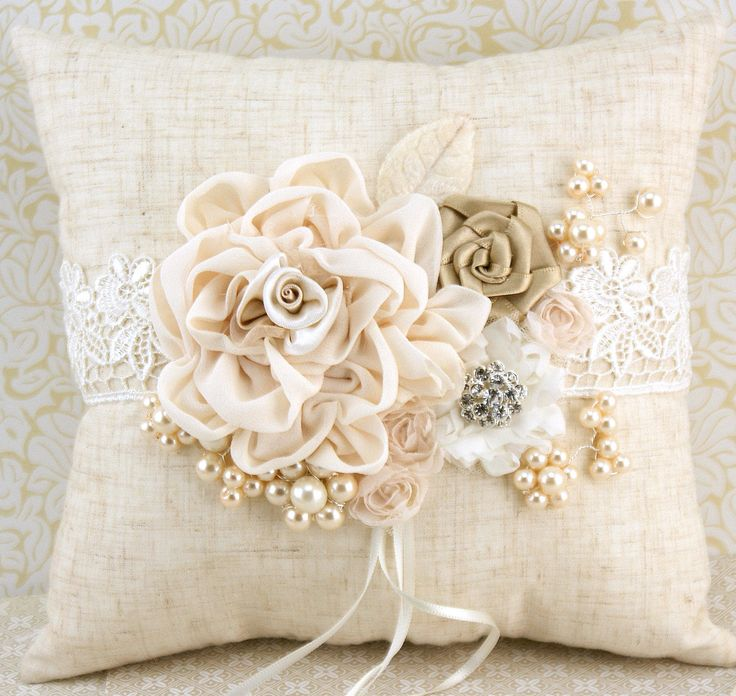 more simple than this but i like the different textures & variety of embelishments Bridal Ring Bearer Pillow in Ivory and Champagne with Linen, Lace, Pearls and Jewels- Shabby Chic Rustic Wedding. $115.00, via Etsy.