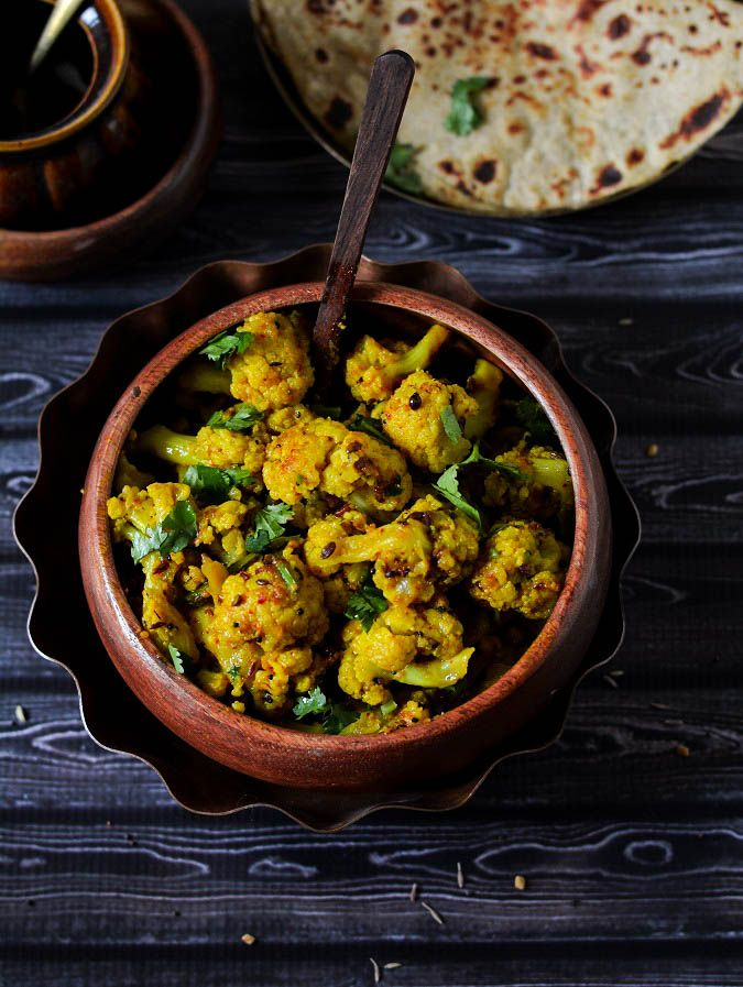 Achari gobhi-Tangy delicious Stir fried Cauliflower cooked with pickle spices- a punjabi preparation