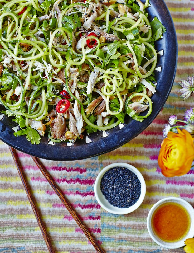 Our Sesame Chicken Salad with Cucumber Noodles is served alongside a tangy sesame dressing.