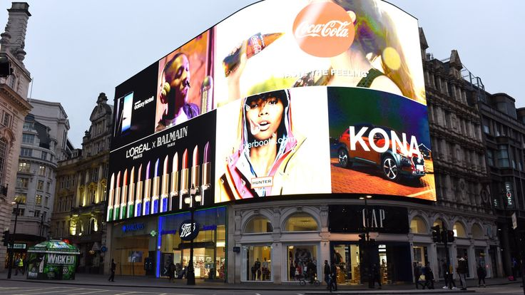 A new digital billboard in London's Piccadilly Circus uses recognition technology to display targeted advertisements based on the make of passing cars, and the gender and age of pedestrians.