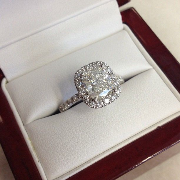 One of our most popular engagement rings! We love this cushion cut diamond halo engagement ring with pave set diamonds. So many celebrity couples have chosen this style of engagement ring, and we <3 it!