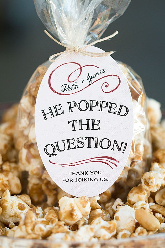 Congratulations! He popped the question, and now you're getting hitched. Share the sweet love with your nearest and dearest with these golden caramel corn wedding favors packaged in cellophane bags with sweet, personalized favor tags. We've included our favorite recipe for caramel corn because it's super scrumptious and easy to make at home, but you could use caramel corn, kettle corn or any other flavor of popcorn you like, whether it's homemade or not.