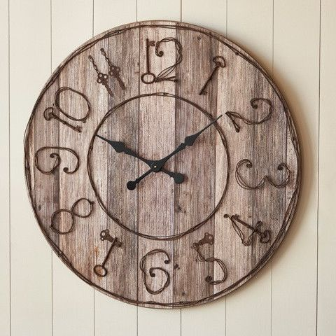 """Made with pieced wood, this rustic clock has key details for the numbers! Dimensions: 32"""" dia. x 2"""" thick >>This item ships directly from our supplier, please allow 3-5 business days before shipment."""