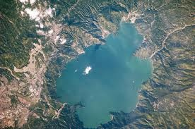 """Lake Ilopango, aerial photography, El Salvador """"...A massive eruption of Ilopango volcano in El Salvador, today a crater lake, may have triggered the global climate cooling of A.D. 536. The only historical eruption at Ilopango took place in 1879-1880, during which a lava dome formed creating the Islas Quemadas in the central part of the lake. .."""""""