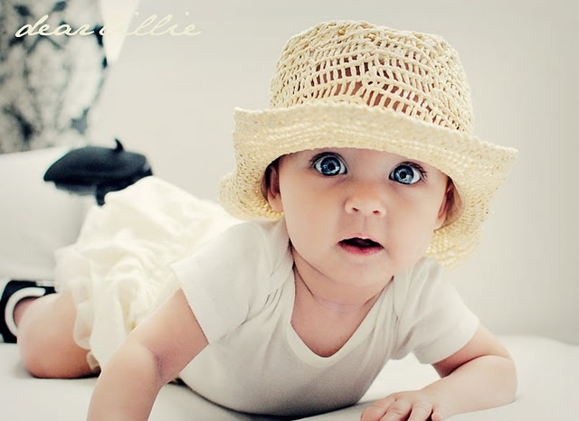 I so want to take good baby pictures like these...