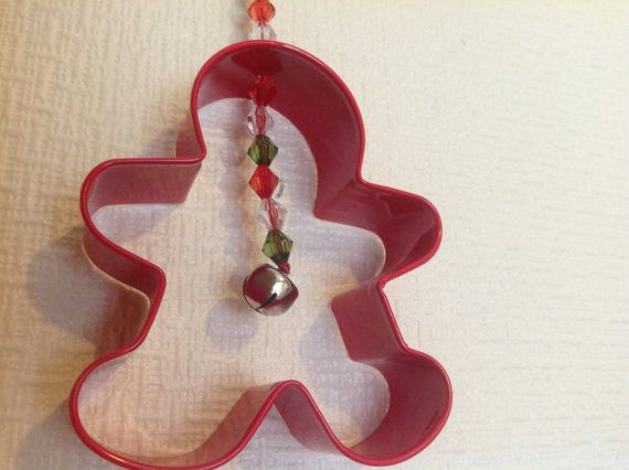 Christmas Gingerbreadman hanging decoration, made from a metal red cookie cutter, it hangs from a pretty string threaded with small acrylic breads, in red, green,white and little bells. It measures approximately 8cm wide and 9cm long from the top of the hanger, the cutter is 13cm tall.     If you have any question please ask I am always happy to help, thanks for looking in my little shop have a lovely day Janet X     P.S  we have free postage in the uk, and cheap postage to the rest of the…