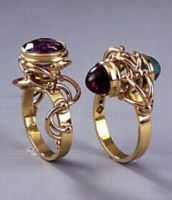Tendrils used in jewelry. Two contemporary rings by Australian jeweler Phill Mason
