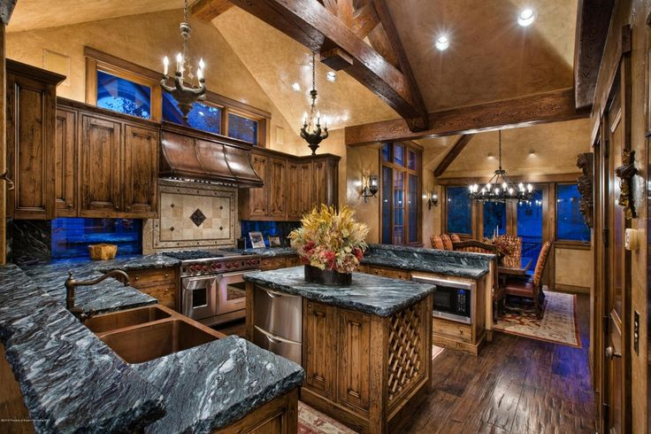 Traditional Kitchen with Exposed beam, Wolfe - 6 burner + griddle, double oven, Kitchen island, U-shaped, Pendant light