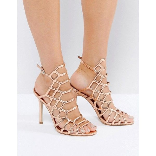 Steve Madden Slithur Rose Gold Caged Heeled Sandals (6,635 INR) ❤ liked on Polyvore featuring shoes, sandals, gold, high heel wedge sandals, open toe wedge sandals, rose gold heeled sandals, ankle strap heel sandals and ankle strap sandals