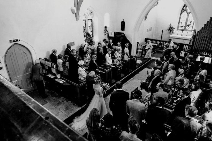 Balconies are a great vantage point to capture impressive moments like the entrance of the bride. Photo by Benjamin Stuart Photography #weddingphotography #balconyphoto #blackandwhite #bridesentrance #aisle #wedding #churchwedding
