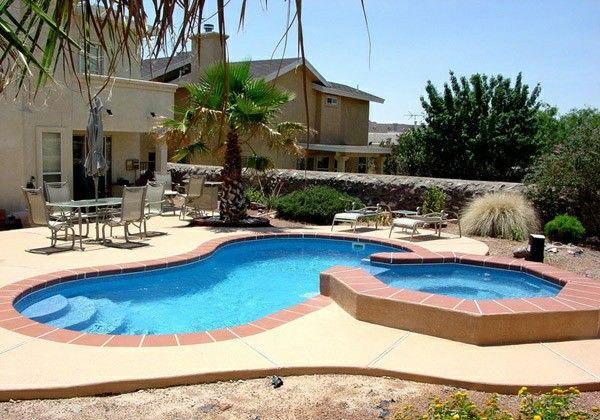 Kidney shaped pool with Jacuzzi In the garden