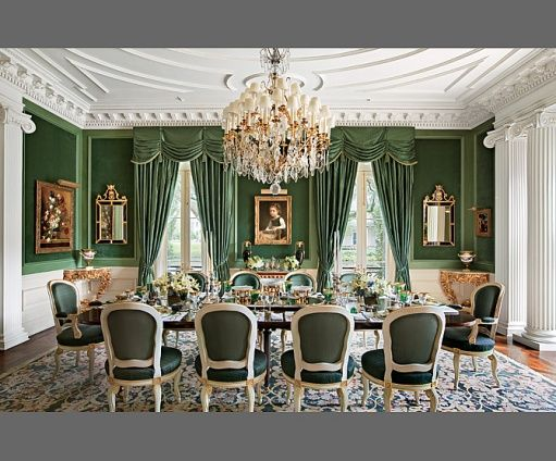 Alexa Hampton went with green paint and green window treatments to make a strong green statement in this dining room...