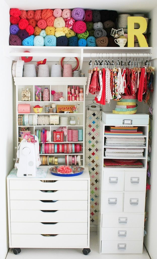 I like the fabric on pants hangers...could hang these from the underside of my craft table.  Also like the yarn shelf.