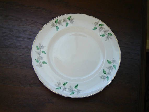 """Salad plate in a grape vine pattern, gold edging  This plate measures 8 3/8"""" (21.3 cm) in diameter  There some (+/- 5%) wear of the gold banding on the edge of the plate but otherwise this item is in very good condition  Made of fine bone china from England by Crown Staffordshire    This item has no nicks, chips, cracks, or signs of repair 