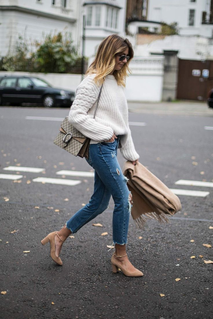 Emma Hill wears cream chunky cable knit sweater jumper, ripped mid wash jeans, mid block heel shoes, oversized camel scarf, Gucci Dionysus bag, chic casual autumn winter outfit