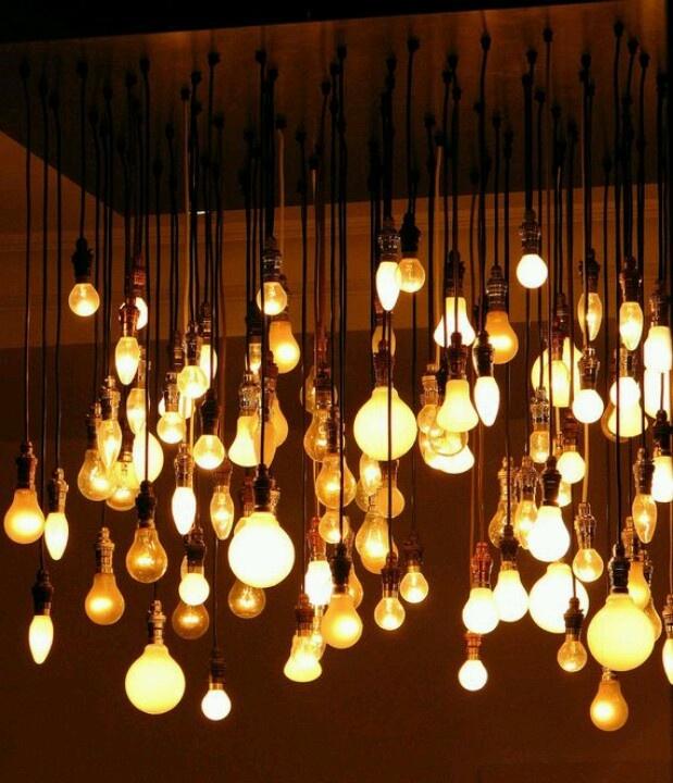 bare mismatched light bulbs descending from a plain wooden panel - what a great light fixture!