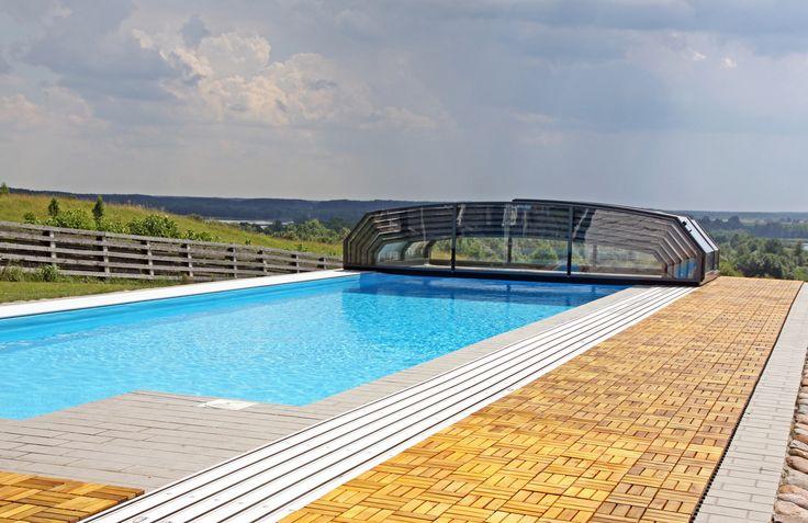Plně stažitelné bazénové zastřešení OCEANIC nízký chránící váš bazén před nečistotami a hmyzem