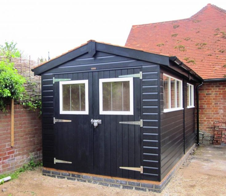 Superior garden shed with double doors this large garden for Large garden buildings