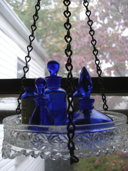cobalt blue bottles in hanging glass bowl...beautiful