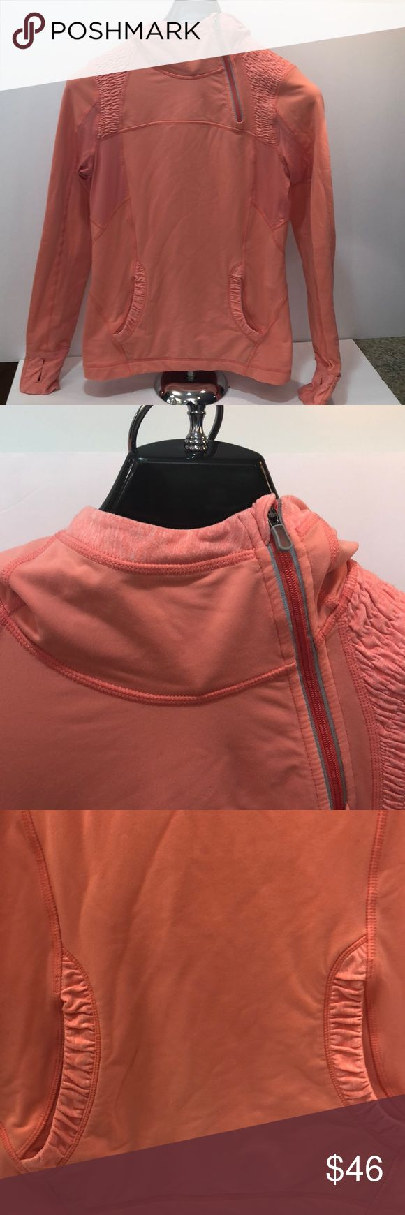 Lululemon pullover with ponytail hole, size 6 Pretty peachy pink (pinker than the pictures) Lululemon Athletica pullover with hood and ponytail hole. Size 6. Has two front pockets, one with inner small key/money pocket and back zip pocket. Make an offer! lululemon athletica Tops Sweatshirts & Hoodies