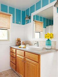 Beach Bathroom Decor - a taller white beaded board can make a room look bigger