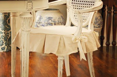 Thinking about making a drop cloth slip cover for Lucy's rocking chair that I found at a thrift store ($5!!)