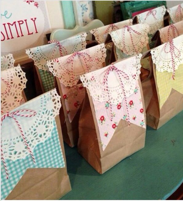 Simple but cute favor bag idea. The combination of the lace, floral patterns and different colored gingham will be the touches added to bring in the southern charm picnic feel to the country farm.