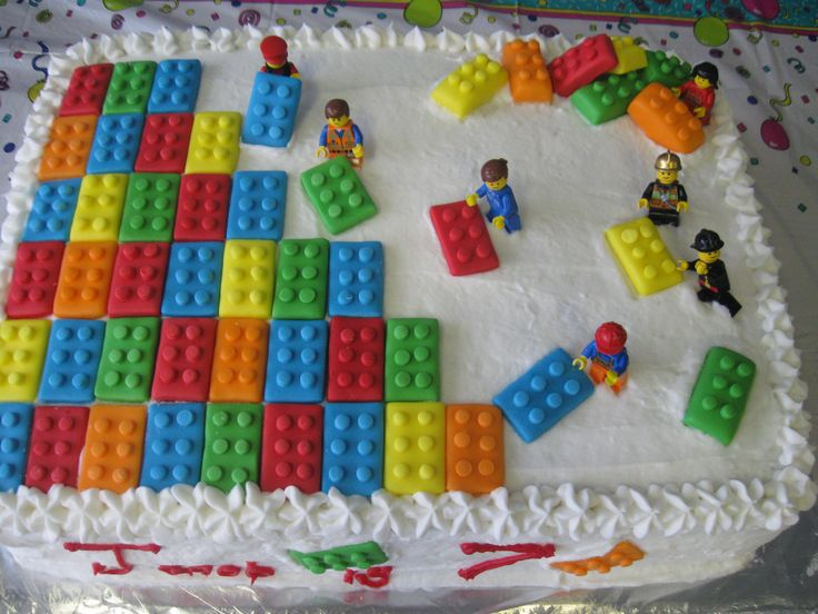 Lego buttercream cake.  Make the Lego shapes out of fondant.  Use fondant cutters for the rectangles and the small circles.  Then add Lego people as if they are building the bricks.