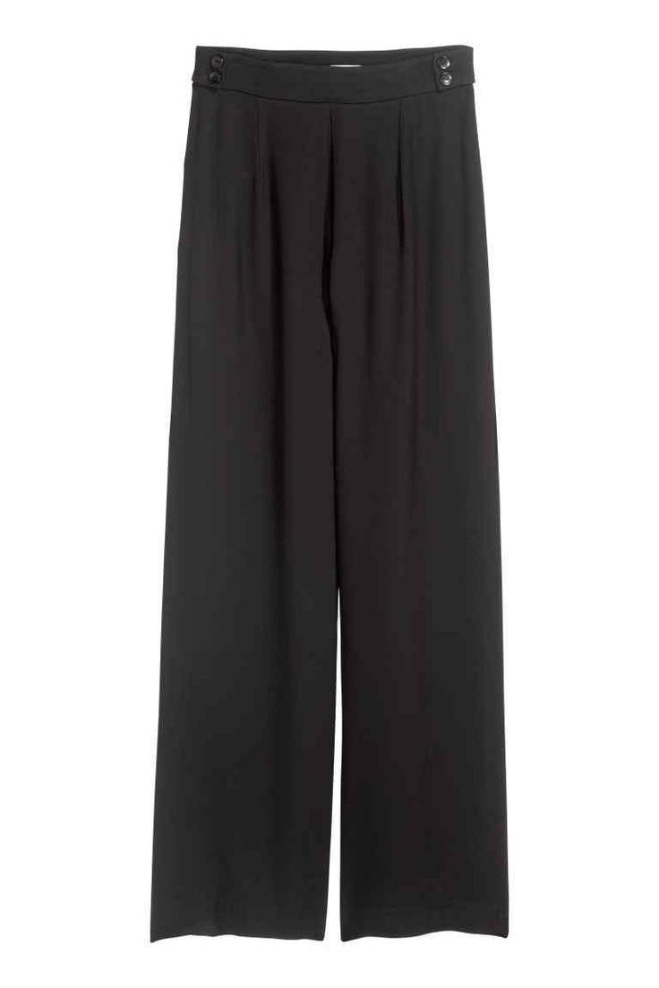 Szerokie spodnie: Szerokie spodnie z miękkiej tkaniny. Wysoka talia z krytym…