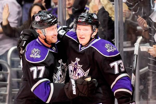 Kings center Jeff Carter (left) congratulates rookie Tyler Toffoli after he scored his first NHL goal. It was just Toffoli's second game in the NHL and he helped the Kings to a 4-0 win over the visiting Coyotes.    Gus Ruelas - AP Images