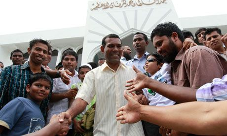 The former Maldives president, Mohamed Nasheed, greets his supporters after Friday prayers in Malé. He has called on his successor to resign. Photograph: Dinuka Liyanawatte/Reuters