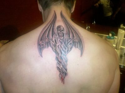 Yes, this is Zak Bagans from Ghost Adventures tattoo. The wings move when he moves his shoulders. Love it.