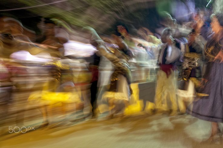 Traditional Greek dancing - Zooming in picture with people dance traditional Greek dancing