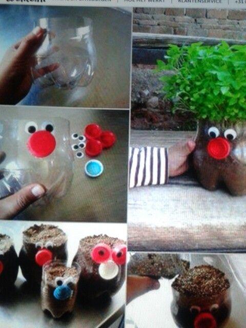 Leuk voor moeder/vaderdag met tuinkers! gemaakt met onderkant PETfles, wat zand en versiersels ( dop=neus ) + zaadjes