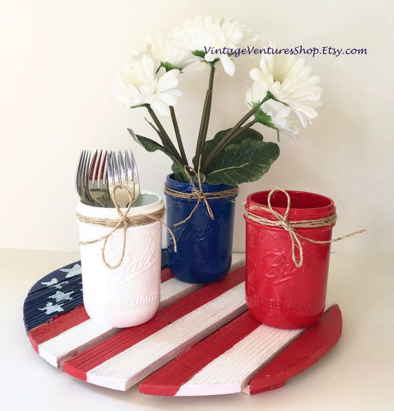 Wood flag painted on round palette wood in red, white, blue US flag theme at #VintageVenturesShop #Etsy to buy click image #MemorialDay #SummerHoliday #IndependenceDay #July4th #Patriotic #Americana #CountryDecor #USflag #Military #MilitaryPride #RusticDecor #WoodWallFlag #MemorialDayDecor #CountryDecor #USflagCenterpiece #PicnicTableCenterpiece #RedWhiteBlue #OldGlory #WoodenFlag #AmericanFlag