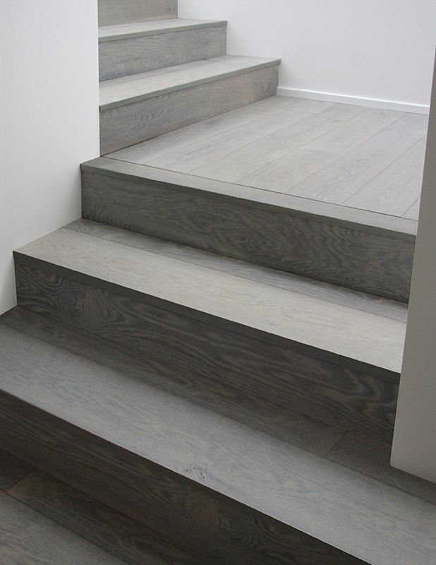 Gray Wood Stairs That Turn A Corner Stain Color