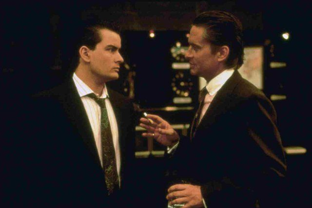 Wall Street (1987)Introducting the world to Bud Fox (Sheen) and Gordon Gecko (Douglas).....Still the hallmark of Wall Street films and in my opinion-- of Oliver Stone.  Disconcerting for sure, Dark; you bet after all other people's money, and insider trading-always are.....A Classic of immense magnitudes.  Go rent it