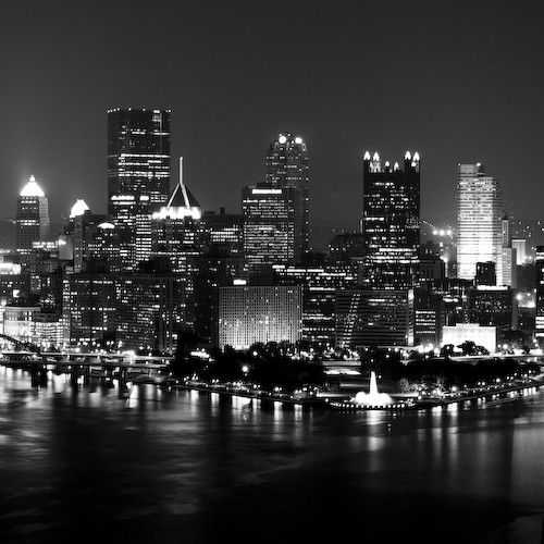 Black and white picture of the Pittsburgh Skyline and the Golden Triangle at night from the Westend Overlook.