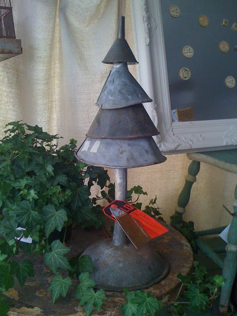 Christmas tree made out of old funnels and other scrap metal