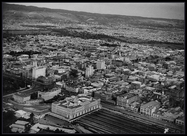 Adelaide 1935    SLSA B6676 Aerial view of Adelaide with North Terrace and the Adelaide Railway Station in the foreground. 1935 Photo by D. Darian Smith.  Visit www.catalog.slsa.sa.gov.au/screens/opacmenu.html to view more photos of South Australia