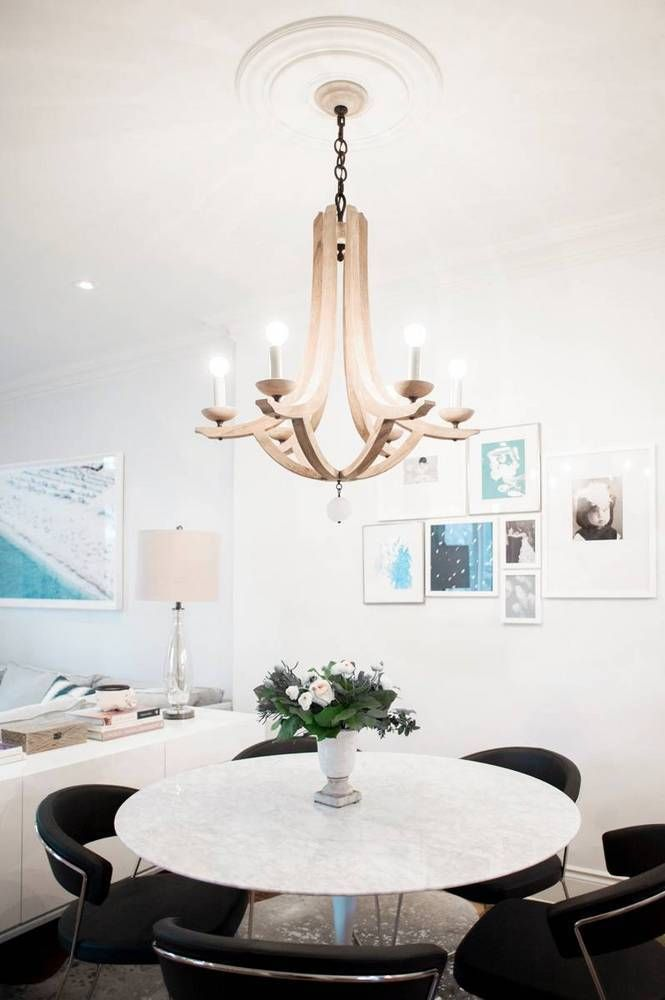 Small space dining solution with a round table and well-designed chairs that tuck neatly away.