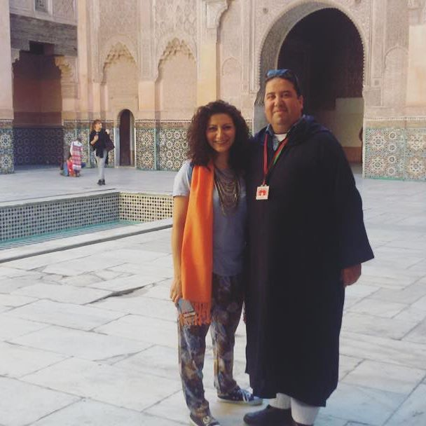 Touriocity's expert Marrakech guide Mohamed and Touriocity customer Anahita, exploring the beautiful Islamic architecture of the Ben Youssef Madrasa. #TouriocityTravel #TravelCurious #Touriocity #Marrakech #Morocco #Travel