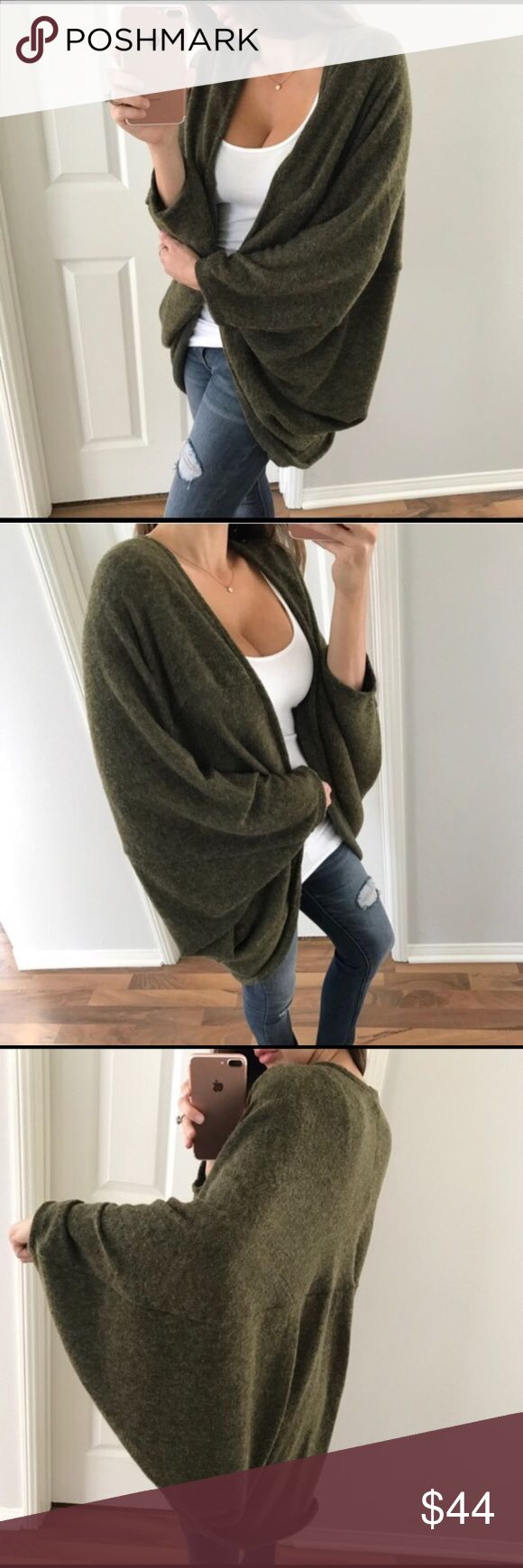 """Olive Cocoon Sweater This is a re-posh.  Beautiful warm sweater but way too big for me.  I ordered a large but this is more suitable for an XL or an XXL.  I'm 5'1"""" with short arms so if you're taller size large would be ok.  Details from the original seller are in the last picture.  From a smoke free home.  When I received this it came packed with fabric softener sheets so the sweater has a floral fragrance. Sweaters Cardigans"""