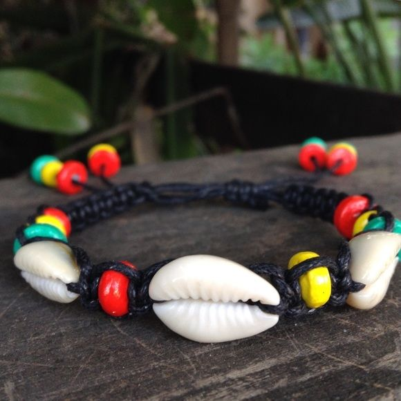 Handmade Jamaican Rasta Shell Anklet/Bracelet Handmade with black waxed hemp cord, NATURAL seashells, & adobe Rasta color beads. Has an adjustable sling knot (fits most wrist sizes) Can be worn as a bracelet/anklet ! ❌PLEASE DON'T BUY THIS LISTING❌ I will create a new listing with this same bracelet/bundle. ➜ Price is firm otherwise bundled ⓢⓘⓩⓔ: Adjustable knot for mostly any wrist size! Jewelry Bracelets
