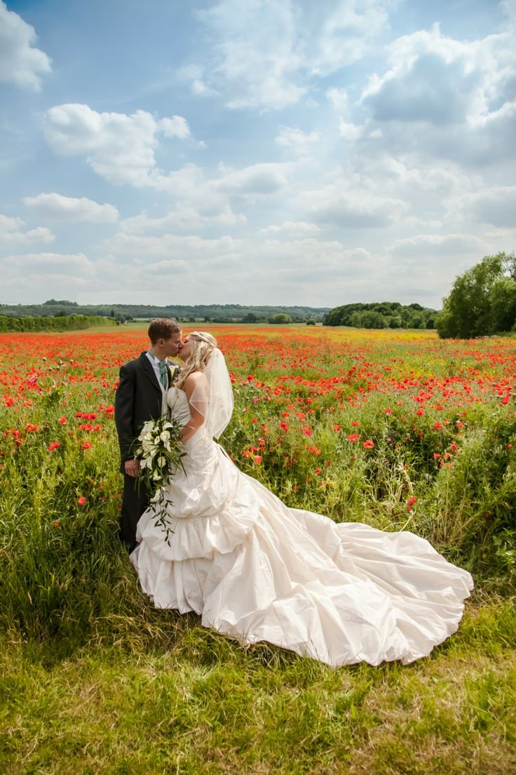Bride and groom in poppy field. Remastered 2014.