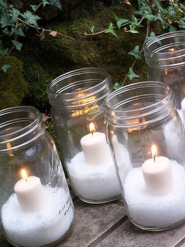 Glittery epsom salt snow in mason jars with white votives. Cluster these around other table decorations for a winter wonderland effect.    Make this weekend for resident holiday dinner