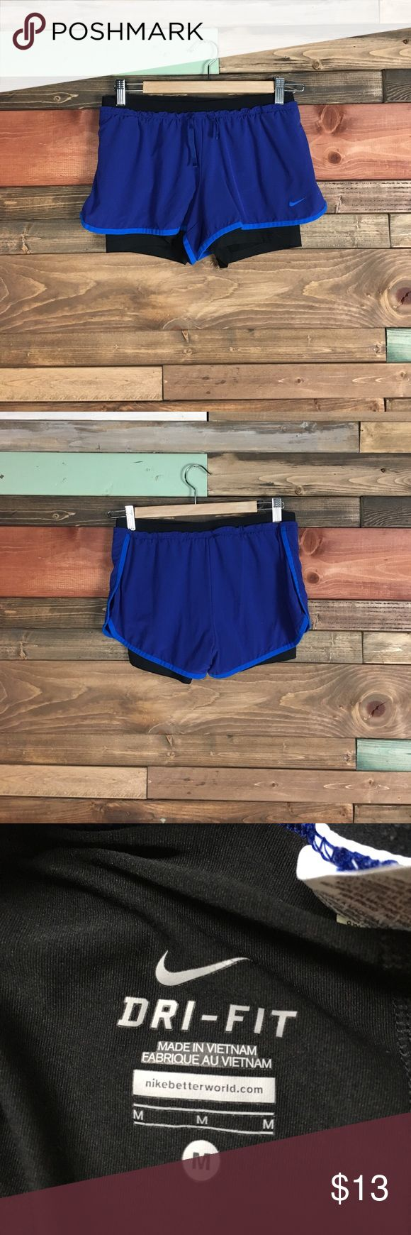 Nike Dry Fit Blue Athletic Shorts with Pockets M Nike Dry Fit Blue Athletic Shorts with Pockets M perfect condition. Worn only a couple times. Hidden Pockets are on both sides of the shorts Nike Shorts