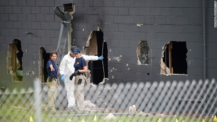 Police investigate the back of the Pulse nightclub in Orlando on Sunday, June…