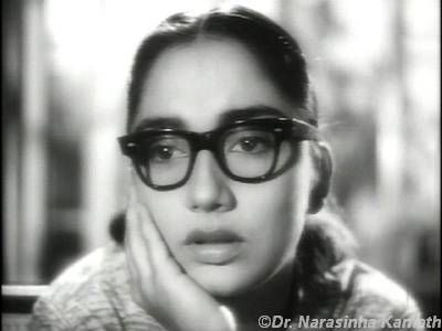 Sadhana Shivdesani (Bollywood veteran actress) in Love in Shimla (which was a huge hit)....she played a nerd in the movie that's why those glasses & no makeup look....but still she looked gorgeous in the movie :)